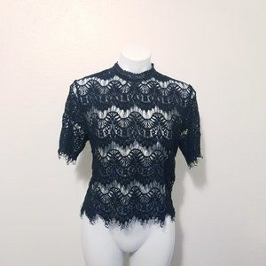 Black Laced top with delicate details